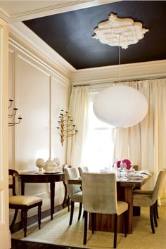 Love the contrasted ceiling, and accenting the chandelier this way is very interesting