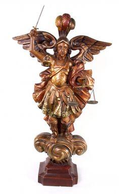 São Miguel Arcanjo, Inicio do século, esculpido em madeira policromada com olhos de vidro. Altura 54