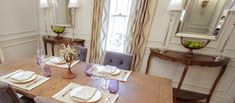 Achieve an appetizing traditional dining room by starting with wood for your dining and accent tables. Bring in dining chairs in solid, subtle upholstery, leather, or timeless prints. Add simple, rectangular mirrors and elegant - but not gaudy - table lamps. See Property Brothers episode 509 for more.