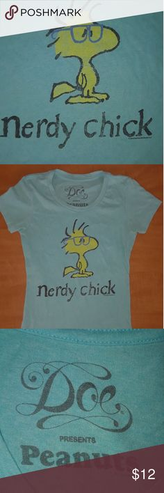 PEANUTS Nerdy Chick Doe PEANUTS Nerdy Chick t-shirt. In excellent condition.  Never worn just tried on. It's supposed to have this old washed look to it. I believe it's an xsmall.   Non smoking home  I do have inside dogs Doe Tops Tees - Short Sleeve