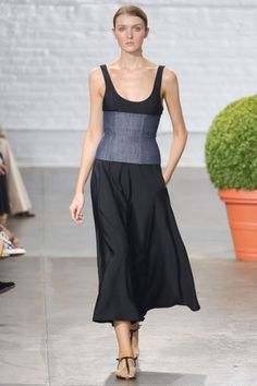 For a night out, Smilovic kept it simple with flowing dresses offset by this black tank maxi with denim corset at the waist—you might call it a little something unexpected.  —Kerry Pieri