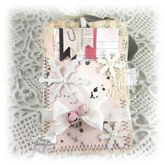 tag created by Teresa Kline  http://paperieblooms.blogspot.com/2012/10/frilly-funkie-challengeanything-but-card.html