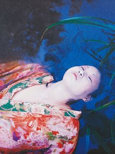 Shinya Fujiwara is a leading cult Japanese photographer, born in the 1940's who spent most of his adult life exploring different continents. 'Colors' contains photographs from his time in America and displays models lying elegantly in a forest near Seattle, dressed in kimonos with coloured threads draped over their naked bodies.