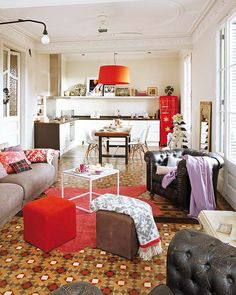 Such an eclectic, homely apartment! Particularly love the red Smeg, leather arm chairs & vintage tiles.