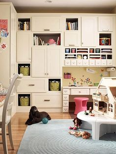 Love Love LOVE this wall of cabinetry for storage in a playroom/craftroom or even bedroom!!! ... The doors on many of them allow for things to be 'hidden' from view, while the open shelves provide that POP of visual impact and colour!!  ... Pic @ Better Homes and Gardens [dot] com