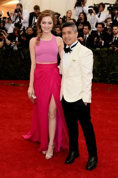 """Actress Emma Stone (L) and designer Thakoon Panichgul attend the """"Charles James: Beyond Fashion"""" Costume Institute Gala at the Metropolitan ..."""
