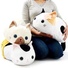 Looking for the purrfect plush kitty to curl up in your lap? Then we have the plushie for you! Meet the Tsuchineko kitties! These big-size plushies measure a sizeable 25 x 25 x 50 cm and are made from a soft material. There is a choice of three to select from: Mike (that's pronounced mee-kay), who comes with a cherry blossom in her fur; Shamu, who comes with a cute blue ribbon; and Jira, who is all tucked up in a blanket around her belly. Take one of these kitty cuties home today!