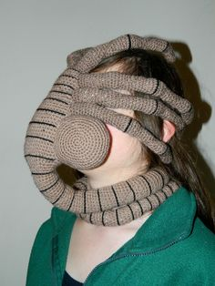 A wearable facehugger (Alien, 1979). Keeps your face warm and comes with a built-in scarf! Who would not want one of these!