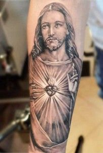 What does jesus tattoo mean? We have jesus tattoo ideas, designs, symbolism and we explain the meaning behind the tattoo. Dream Tattoos, Body Art Tattoos, Sleeve Tattoos, Jesus Tattoo Sleeve, Rib Tattoos, Flower Tattoos, Jesus Tattoo Design, Forearm Tattoo Design, Trendy Tattoos
