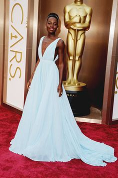 I love this modern take on a Grace Kelly Style gown. Lupita Nyong'o. Prada & Fred Leighton.#Oscars2014