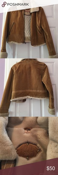 Wilson's Leather Brand short suede jacket Beautiful short  tan suede jacket with soft collar and sleeve ends. Genuine Wilsons Leather suede. Size Small zip front and zip pockets. Hardly wore. Very very good condition Wilsons Leather Jackets & Coats