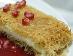 this w coconut delish!Shredded Phyllo Pastry with cheese (Kunafa bi Jibin) Greek Sweets, Greek Desserts, Arabic Sweets, Arabic Food, Sweets Recipes, Cooking Recipes, Lebanese Desserts, Lebanese Recipes, Middle Eastern Desserts