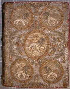 Detail of the beautiful embroidered binding showing the lion motif.