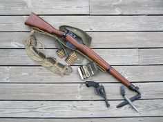No.4 MkI rifle, .303 rounds in clips & bandolier, rifle maintenance kit, No. 9 bayonet & Webley revolver