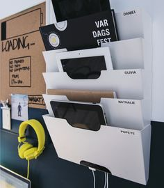 Close-up of a wall newspaper rack used as a customised charging station for…