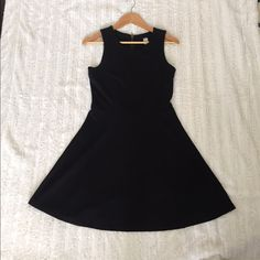 Old Navy Black Dress Never worn Old Navy Black dress in size M Petite fits like small M.  A-line back zipper and stretch material.  Knee-Length. Old Navy Dresses