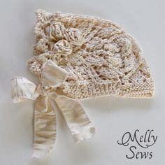 Lace Knit Baby Bonnet - Free pattern  by Melissa at  Melly Sews
