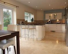 photo of open plan beige brown kitchen kitchen diner