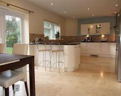 photo of open plan beige brown kitchen kitchen diner