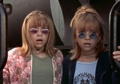 Mary Kate and Ashley wearing round, tinted frame sunglasses: