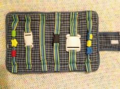 DIY buckle toy. I like that this one has velcro to roll and close it up.