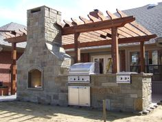 Outdoor kitchen/fireplace combo