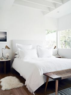Clean and cozy white bedroom