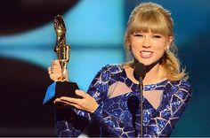 Taylor Swift accepts the Top Artist awards at the 2013 Billboard Music Awards | 60 Memorable Moments From Past Billboard Music Awards