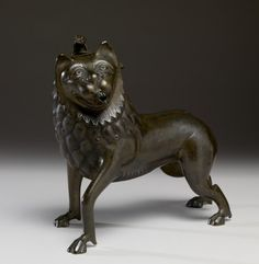 Aquamanile in the Form of a Lion. German (?) (Artist)  Netherlandish (?) (Artist)  late 13th or early 14th century (Late Medieval)  brass  H: 9 1/8 x L: 10 5/8 x D: 5 1/16 in. (23.2 x 27 x 12.9 cm