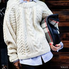If there's a singlepiece of knitwear we associate with fall, it's the fisherman sweater. Whether it's a classic Aran sweater from the Aran Sweater Market or amodern interpretation of the cable knit sweaterfrom Ryan Roche, Trade Mark, Carven or Kule,these cozy knits are an essential part of