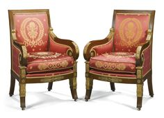A pair of Empire style gilt-bronze mounted, parcel-gilt mahogany and upholstered bergères