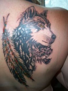 30f9286648c82 Cute Wolf Tattoo Cute wolf and feathers tattoo Wolf Tattoos, Feather Tattoos,  Watercolor Tattoo