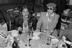 Glenn Frey (left) of American rock group The Eagles, with English singer-songwriter Elton John at a party given by the American group, April (Photo by Michael Putland/Getty Images) The Heat, The Band Album, Amy Irving, Last Tango In Paris, Billy Preston, The Glenn, Eagles Band, Ron Woods, Glenn Frey