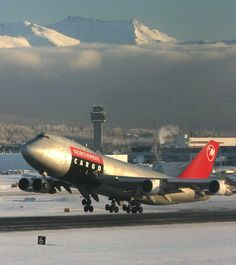 Northwest Airlines Cargo Boeing 747-300 lifts off from Ted Stevens Anchorage International Airpor--- AlaskaFoto © 2007 Rob Stapleton
