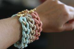 Pretty crochet bracelets. What a great use of costume jewellery!
