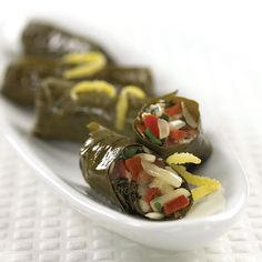 A cheesy take on a Greek classic – a fresh, bright and light appetizer. Light Appetizers, Vine Leaves, Lemon Slice, Roma Tomatoes, Fresh Mint, Other Recipes, Vines, Vegetarian, Stuffed Peppers