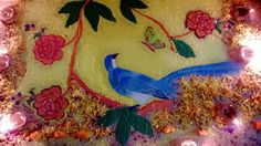 Creative Indian Rangoli design for Diwali festival based on Chinoiserie pattern with birds, flowers, leaves, butterfly/butterflies, diyas/ lamps bordered with marigold flowers #PinOfTheDay