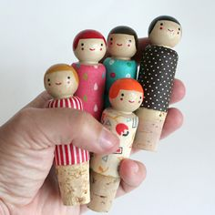 Wine Bottle Stoppers I think these would be easy to make with corks and peg people..Maybe make a peg person stopper to resemble family members!