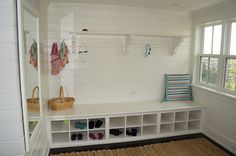 Enclosed porches are a great place for a mudroom. This once blank exterior wall was transformed into a functional and stylish makeshift mudroom. From Our Blog at Design Connection, Inc. | Kansas City Interior Design http://www.designconnectioninc.com/the-dirt-stops-here-creating-your-ideal-mud-room/ #InteriorDesign