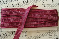 "1y Vintage French 1930s Cranberry Pink by VintageCottageFinds, $11.00  Antique Vintage French Metallic Plisse Ruched Millinery Ribbon Trim     Pretty Pleated Ribbon   Deep Cranberry Pink (a little darker than my pictures show)   Silver Metallic ~ So beautiful in person ~ very shimmery    Made of Rayonne & Metallic ~ Soft and Pliable  Unused old store stock ~ Made in France, c1930s  Excellent Condition     1 yard listing ~ a little over 3/8"" wide"