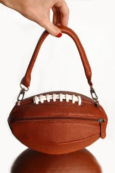 Oh honey I found me a new purse !!!!!, I swear you will love it and you will be a puffed up  a man buying it.         football - Go Team!