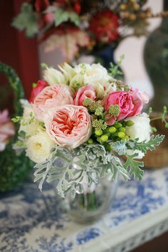 Pink-Ranunculus-Centerpiece...this would be perfect for the tables outside.