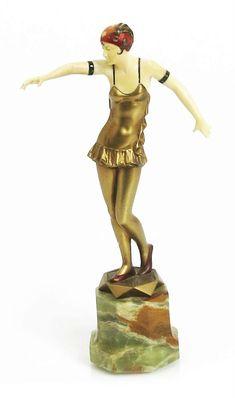 λ  'Dancer' a cold painted bronze and ivory figure cast and carved from a model by Ferdinand Preiss