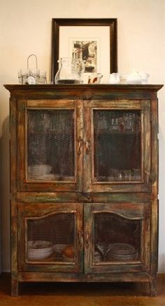 One of Ainsworth's favorite furniture pieces is this cabinet given to her by her sister. The cabinet is painted with a BioShield stain to give it a rustic, ranch-inspired feel. Primitive Furniture, Rustic Furniture, Vintage Furniture, Painted Furniture, Primitive Decor, Furniture Ideas, Refurbished Furniture, Furniture Redo, Country Primitive