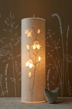 Hannah Nunn, beautiful cut paper lamps.