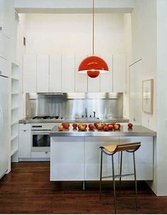 Above: A red Verner Panton Flowerpot lamp in a NYC kitchen by Messana O'Rorke Architects. Kitchen Counter Stools, Kitchen Countertops, Kitchen Dining, Countertop Backsplash, Urban Kitchen, Red Kitchen, Nice Kitchen, Kitchen Small, Kitchen Layout