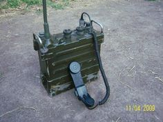 """AN/PRC 77 Radio Set is a manpack, portable VHF FM combat-net radio transceiver manufactured by Associated Industries[1] and used to provide short-range, two-way radiotelephone voice communication.[2] In the Joint Electronics Type Designation System (JETDS), AN/PRC translates to """"Army/Navy, Portable, Radio, Communication."""""""