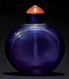 CHINA    Snuff bottle blue glass in Beijing. Late eighteenth early nineteenth century. Colored glass stopper