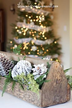 Nature-inspired centerpiece - put pine cones and evergreen sprigs in a wooden tool caddy/crate