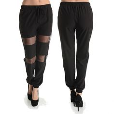 Loose fitting black jogger style pants with mesh front inserts.  Fits true to size. $40.00
